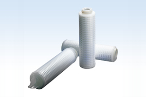 [photo] Three microfilter cartridges, one standing upright and two laid down