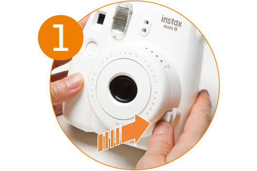 [photo] Close up of the Instax Mini 8's power button