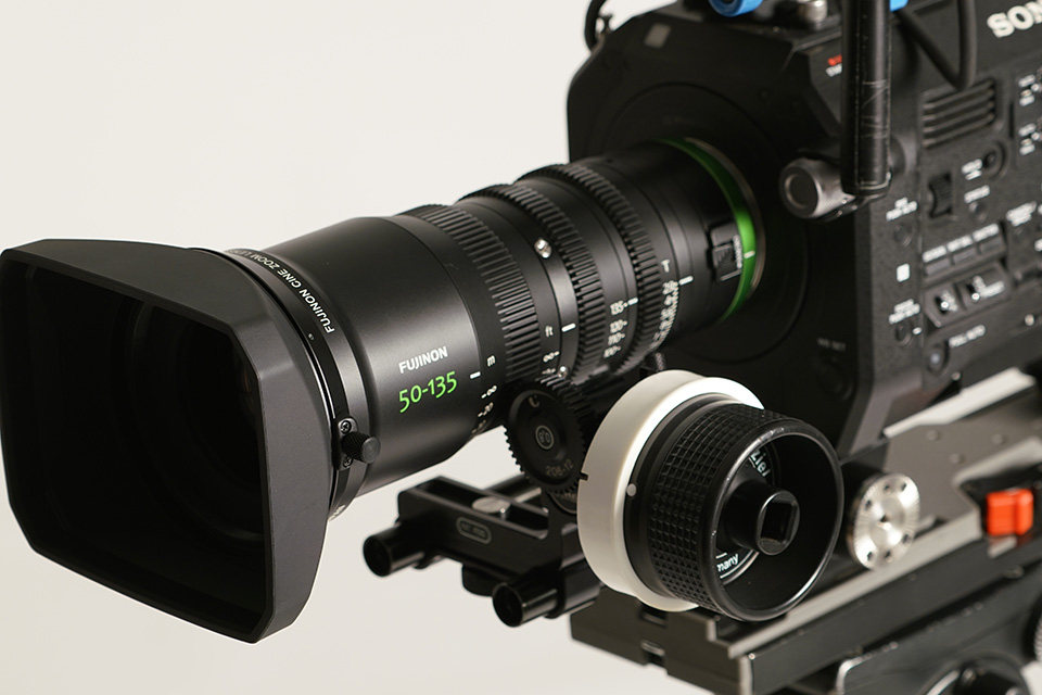 [photo] A close up show of the Fujinon 50-135mm with a follow focus on the Sony digital camera