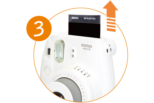 [photo] Close of the Instax Mini 8 printing a photo