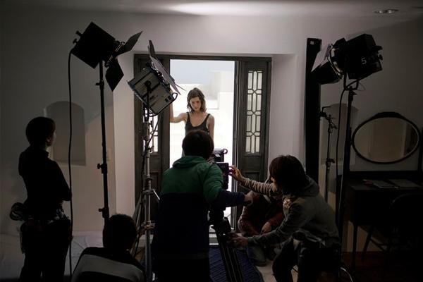 [photo] A film crew shooting a woman standing at an open door