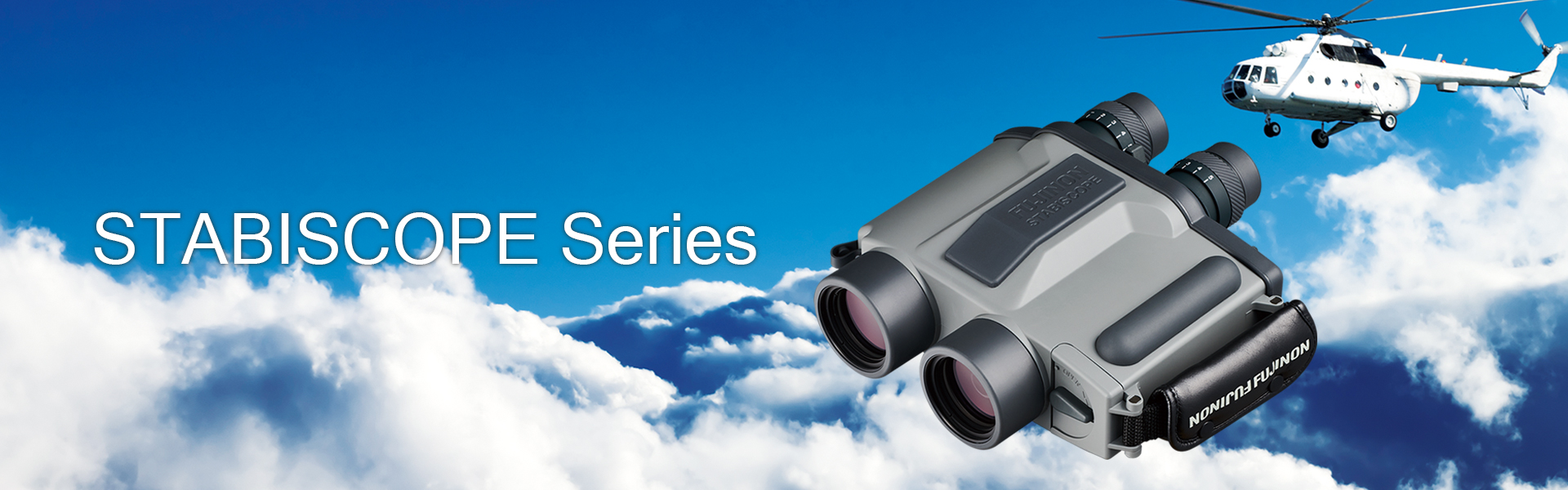 [photo] STABISCOPE Series binoculars in front of a high-altitude-sky, cloudy background with white helicopter flying