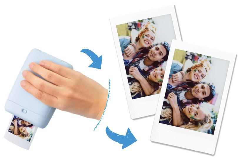 [photo] Hand holding printer upside down, while printer prints photo