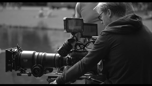 [photo] Man in glasses filming behind a camera with HK/ZK lens