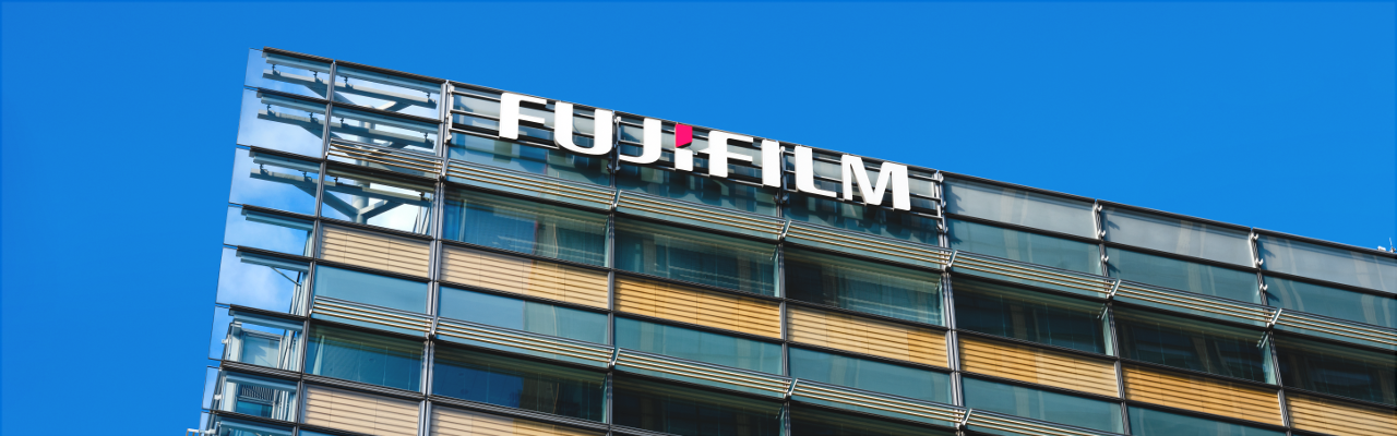 [image] Corporate building with large Fujifilm text logo on corner of building