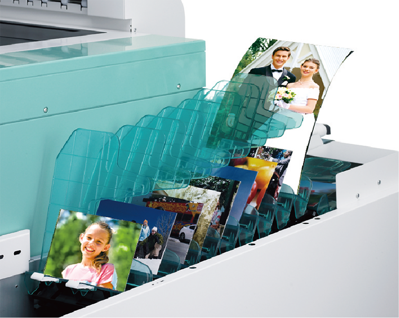 [photo] Print and photo organizing tray, full of various photos, attached to DL600 printer