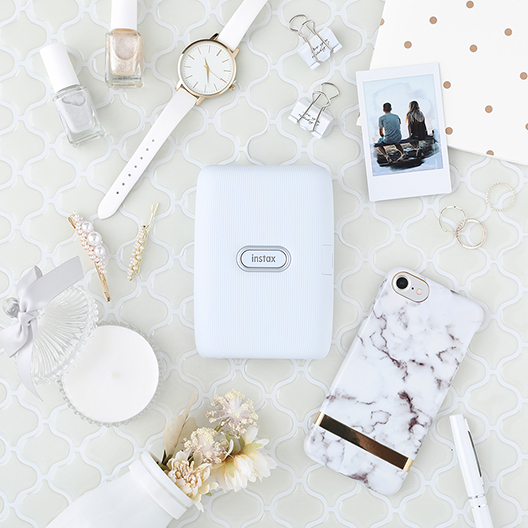 [photo] White Ash printer surrounded by other white colored accessories and items