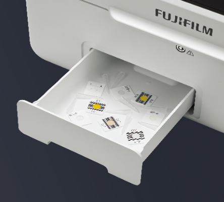 [photo] Disposal box/slot open and pulled out from machine, with multiple discarded slides inside