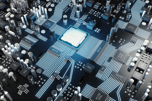 [photo] Circuit-board with bright-blue reflection of light shining on CPU chip in middle of board