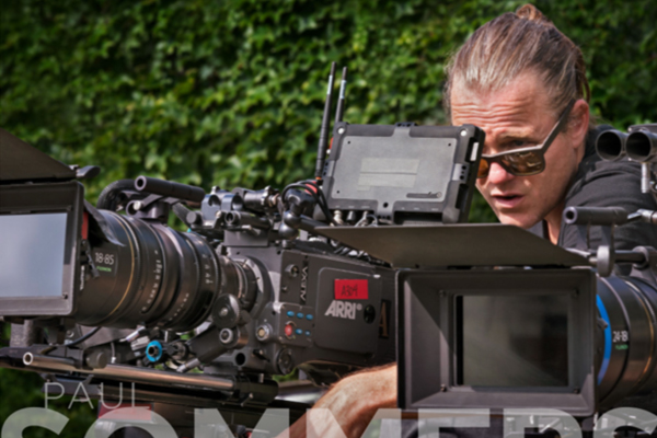 [photo] A cameraman framing a shot through a viewfinder on an Arri camera body and Fujinon 18-85 lens outside