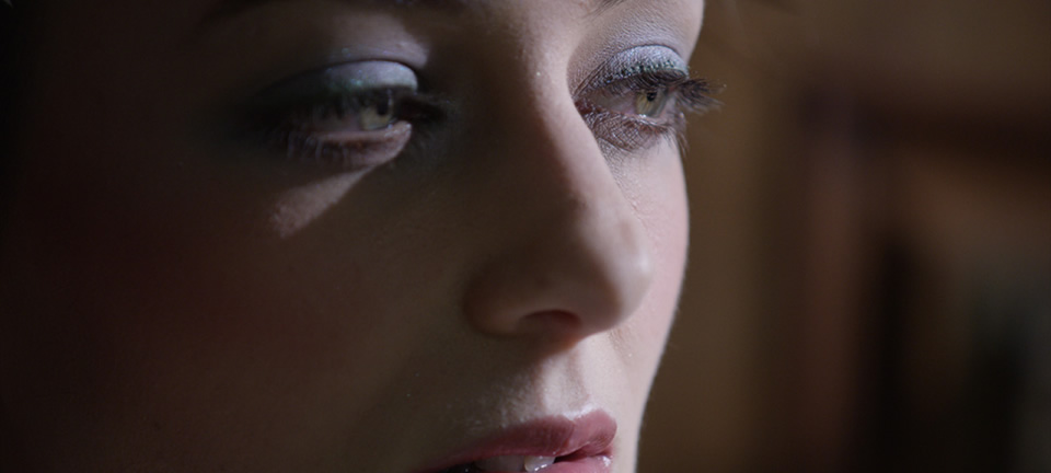 [photo] A very close-up view of a lady eyes, nose and lips