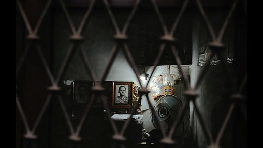 [photo] Dimlit room with a picture in the background next to a lamp
