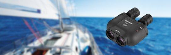 [photo] Fujinon Binocular with a blurry picture of a yatch on the ocean