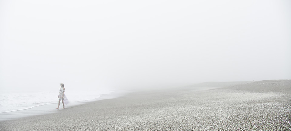 [photo] A wide shot of a lady walking on the beach