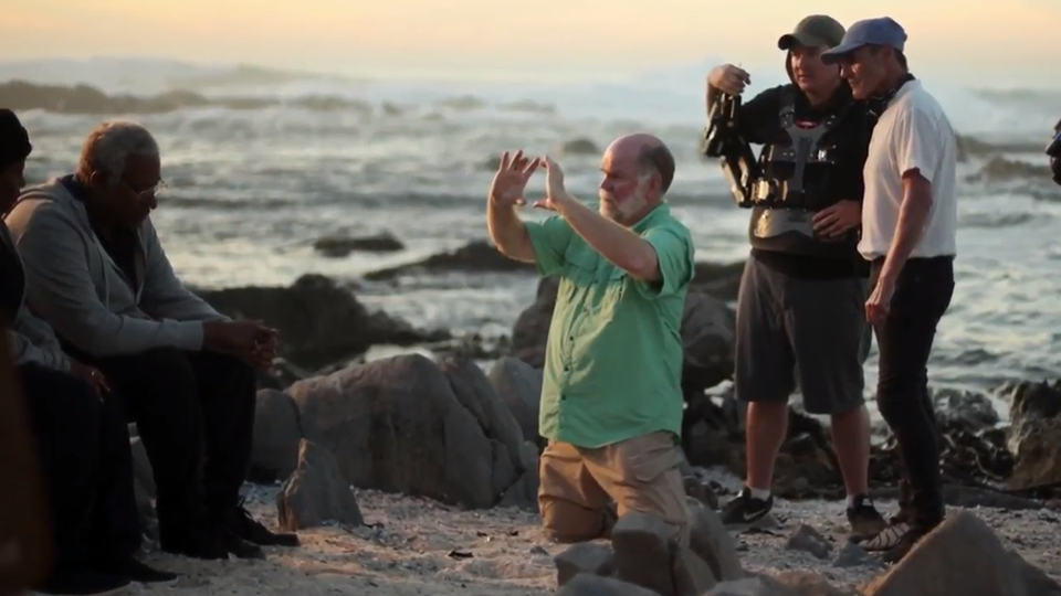 [photo] Cinematographer William Wages setting up a shot by the ocean with a crew and actors