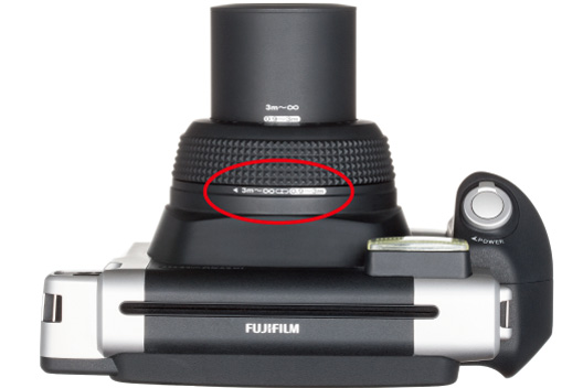 [photo] Top view of the Instax WIDE 300 camera with a red circle drawn around the Focal Zoom Dial