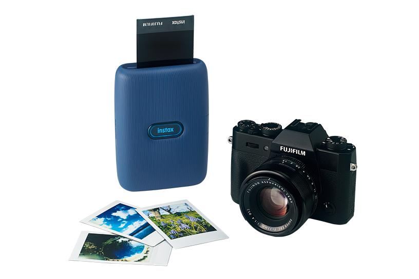 [photo] instax mini Link printer in Dark Denim color printing photo next to digital camera and photo prints