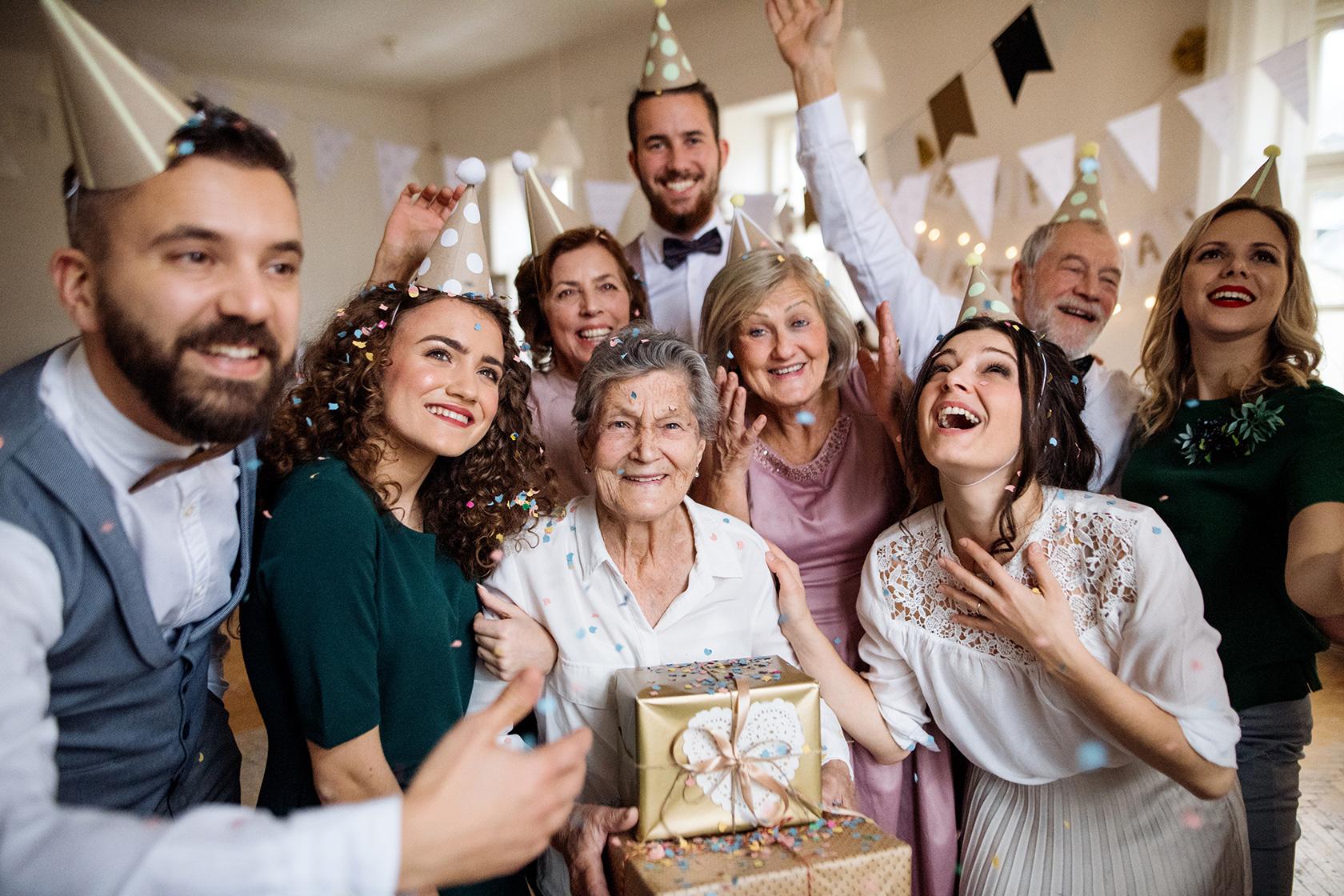 [photo] A family surrounding their grandma celebrating her birthday