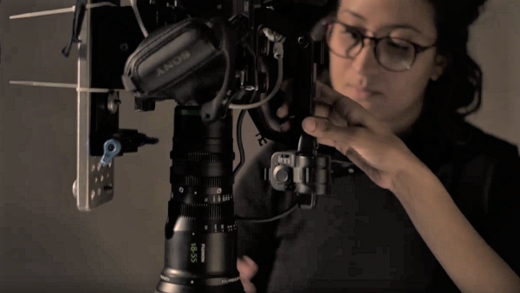 [photo] Woman filming on camera using Fujinon MK lens