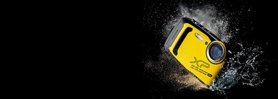 [photo] Fujifilm FinePix yellow digital camera splashing into water