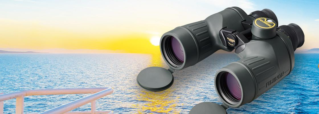 [photo] FMT Series Binoculars with a sun setting over the ocean background