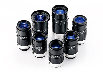 [photo] An assorted collection of Fujifilm Machine Vision lenses on a white background