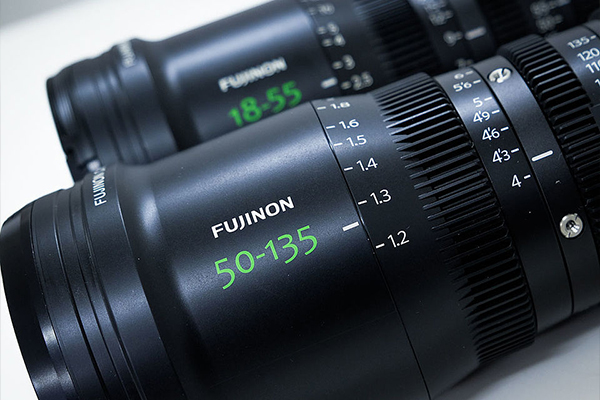 [photo] Close-up of Fujinon 50-135mm and 18-55mm lenses on a white table