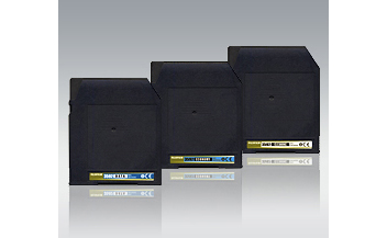 [photo] 3 High capacity storage media cartridges in black with a gray background