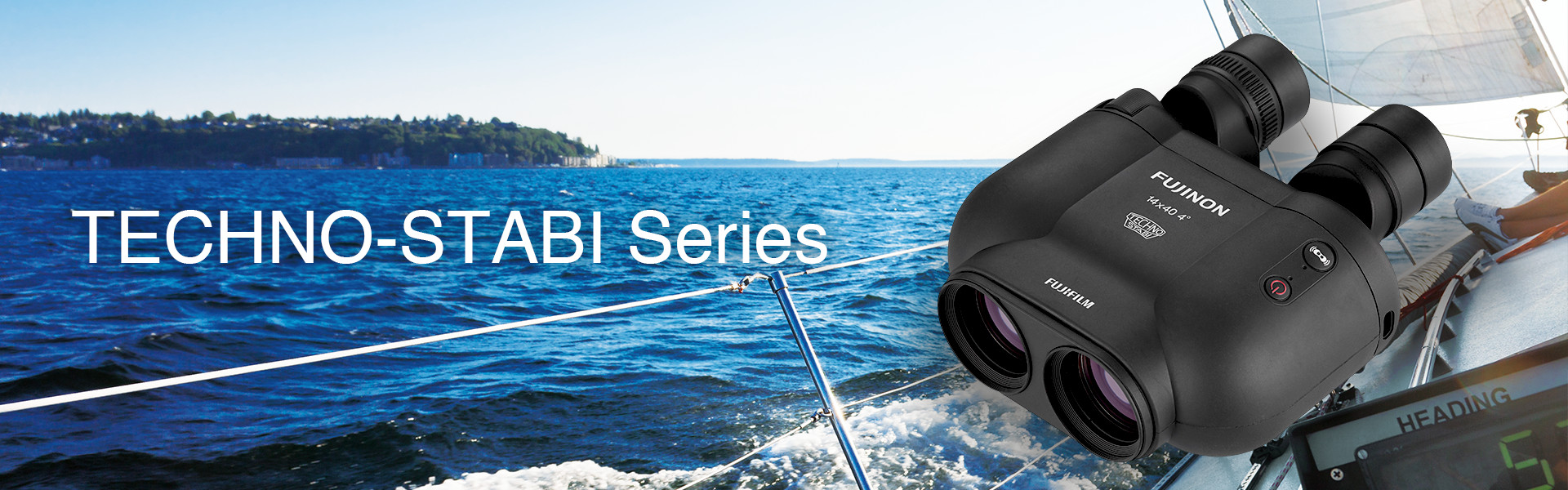 [photo] TS-X 1440 binoculars in front of background of ocean view from a sailboat
