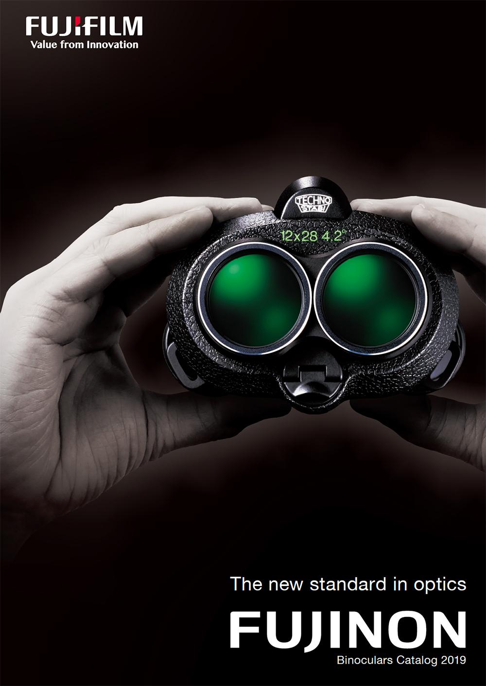 [photo] Hands holding Fujinon binoculars that have dark green lenses