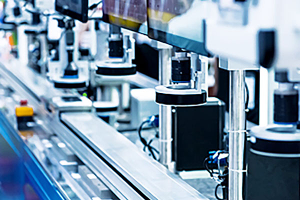 [photo] A close-up view of a lens inspection assembly line