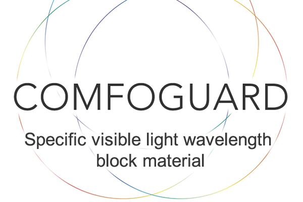 [photo] Ortada COMFOGUARD metni ve altta spesifik görünür ışık dalga boyu blok malzeme metni bulunan çok renkli ince kenarlı iç içe daireler