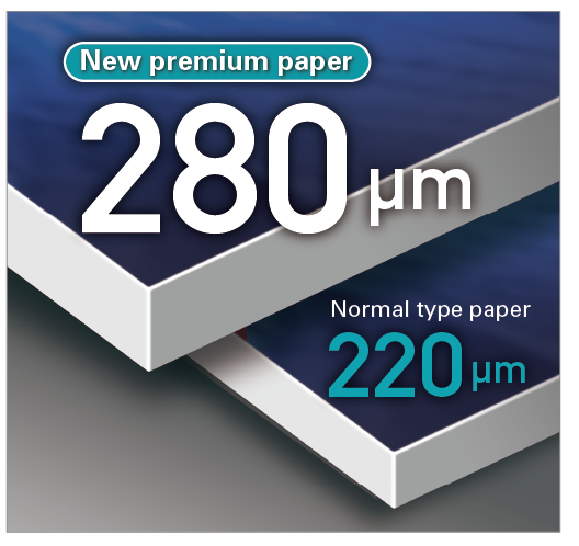 [image] New premium paper with 280μm thickness resting on normal type paper of 220μm thickness