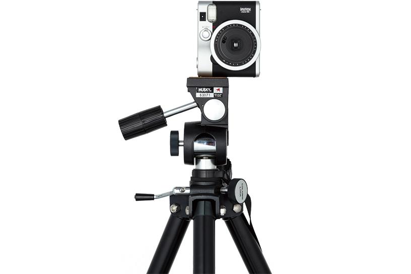 Photo of black Mini 90 mounted vertically on tripod