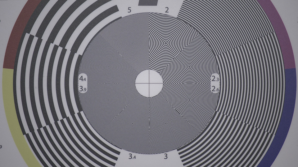 [photo] One big circle with wavy lines on a lens test chart