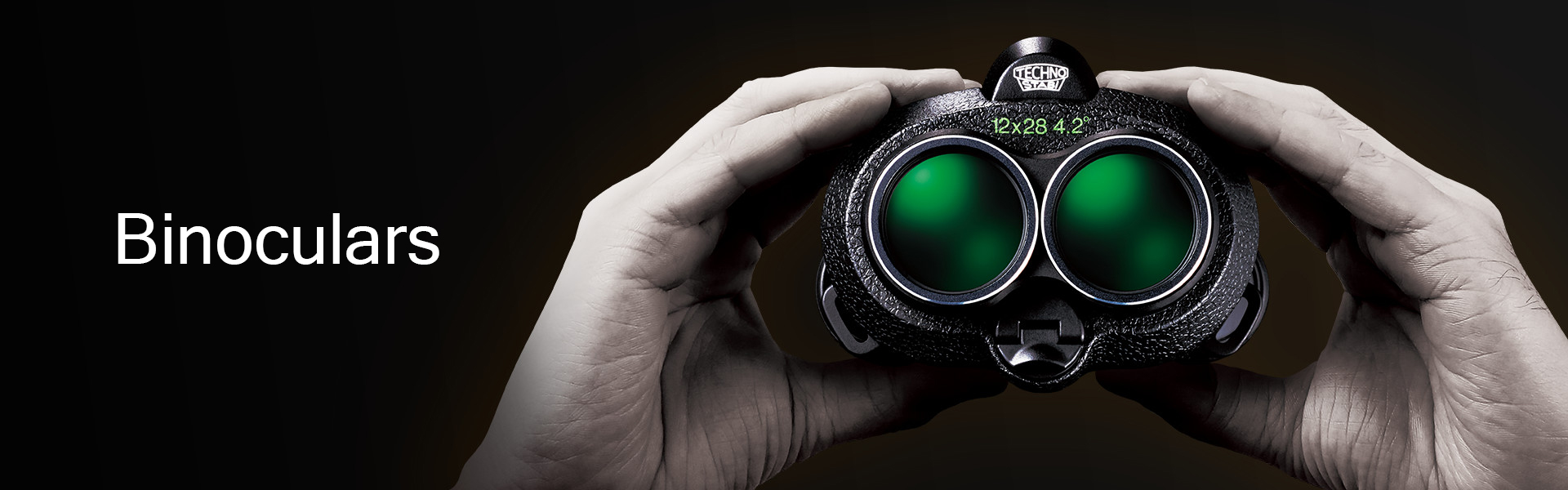 [photo] Two hands holding Techno-Stabi Series binoculars that have green lenses