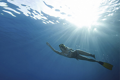 Image of young lady swimming under water
