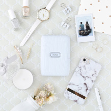 image of white mini link printer and other items on the table
