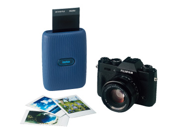 image of blue mini link printer, digital camera and pictures
