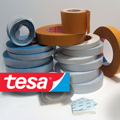 [photo] A stack of mounting tapes with a red and blue tesa logo stamp
