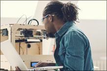 Technician Repairing 3D Printer