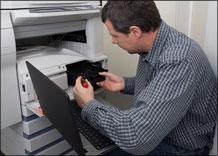 Technician Installing Printer