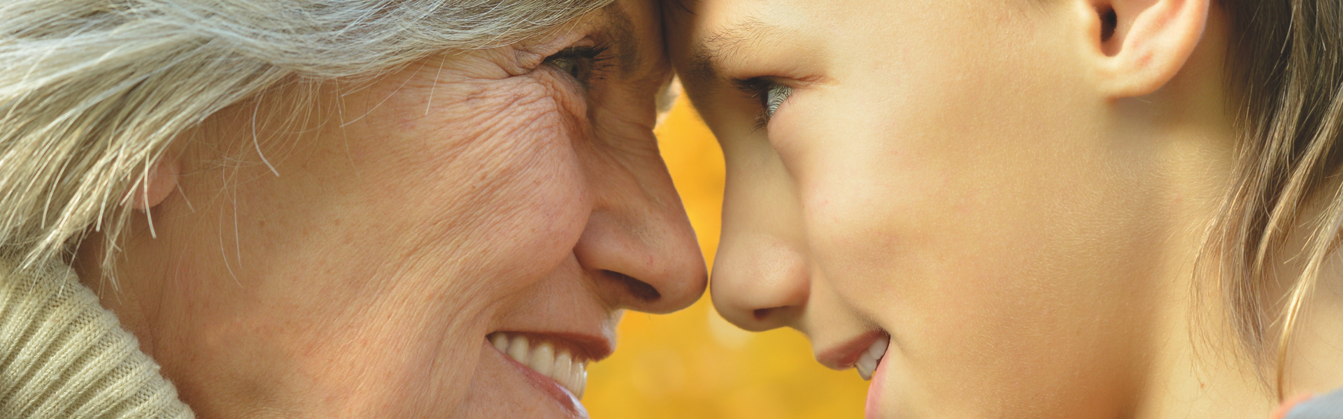 Older women and child looking into each others eyes with foreheads pressed together