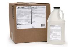 [photo] Developer Starter large, clear chemical bottle in front of cardboard box