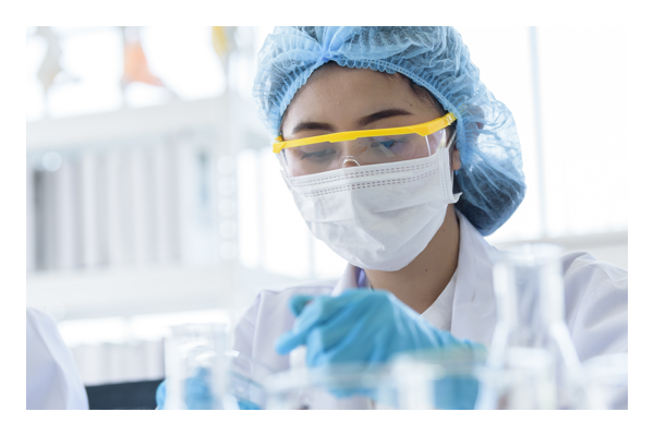 Women working in lab wearing safety equipment
