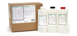 [photo] Developer Systems Cleaner clear chemical bottles in front of cardboard box