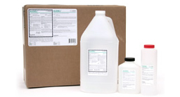 [photo] Automatic Developer clear chemical bottles in different sizes in front of cardboard box