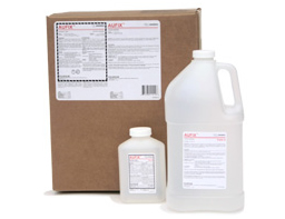 [photo] Universal Fixer clear chemical bottles in large and small sizes in front of cardboard box