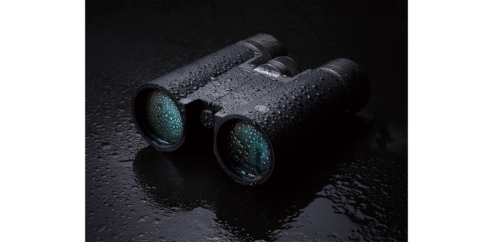 Black Hyper-Clarity Series binoculars splashed with water droplets