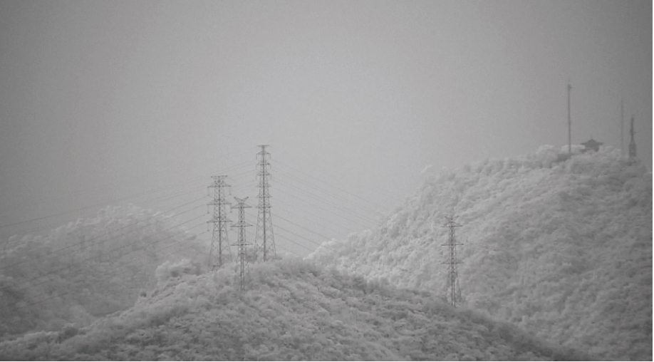 [photo] Blurry image of grey, snowy hill landscape with decreased visibility compared to enhanced and clear image of snowy hills